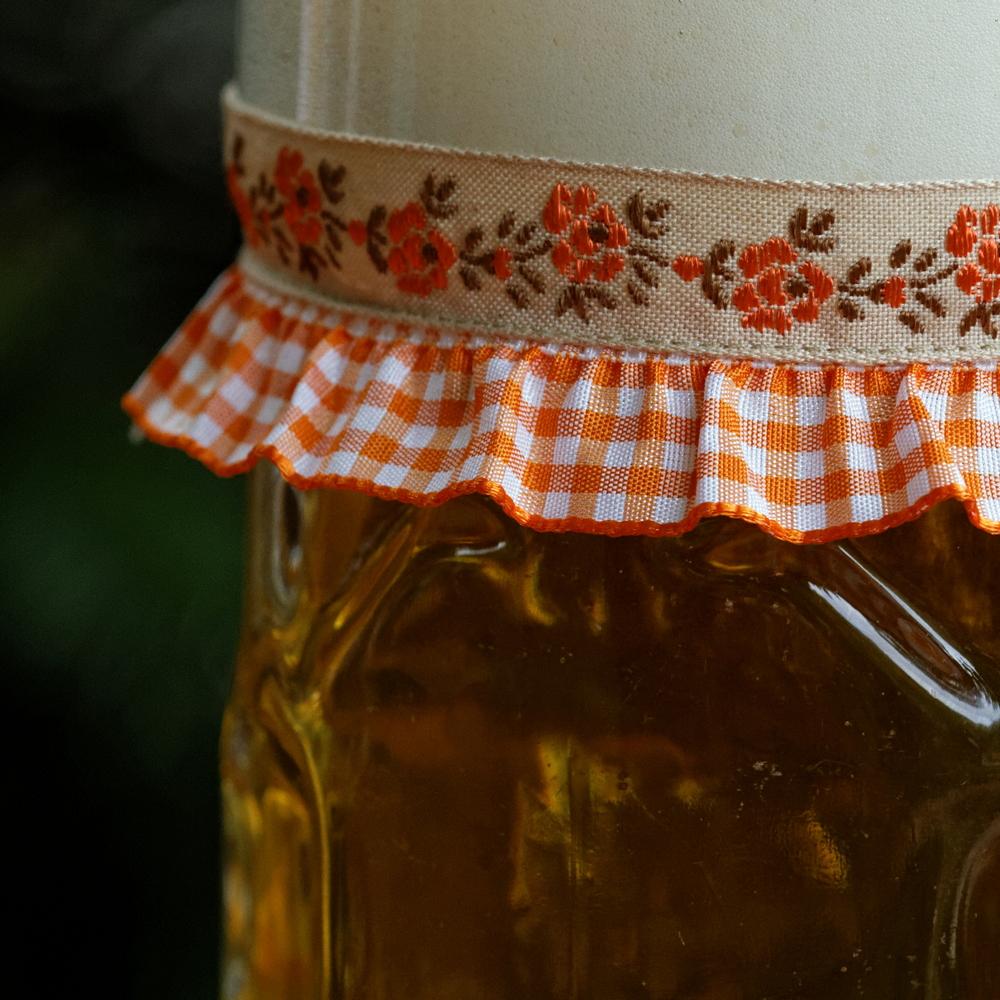 Vronikaa Maßkrugband Blumen Orange